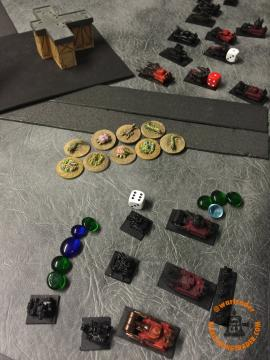 A bunch of Disrupt hits left the small formation of Warbuggies near to breaking, and 4BM on the Gunwagons behind. Miraculously, the nine Plague Zombies didn't take any BMs when landing. The white dice showed the coordinates for the barrage, with the Zombies placed as close as possible while respecting enemy ZoC.