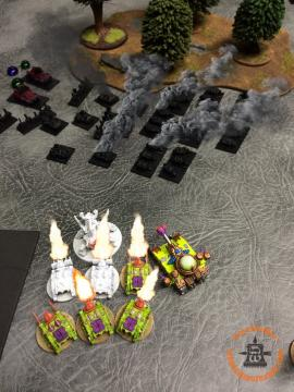 Death Guard Activation: By now, the Orks were out of activations, so it was time to set up the big bust up in the middle. The Vindicators Advance and manage to inflict nine kills by hitting the Trukks! Thinking ahead a couple of activations, the Vindicators themselves cower behind their CC friend, the Plague Hulk.