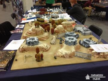 SMG desert table with Warmill terrain.